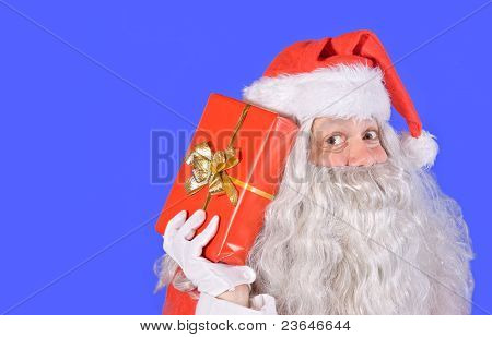 Santa Claus holding a gift