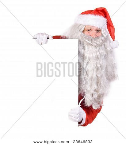 Santa Claus holding a blank sign