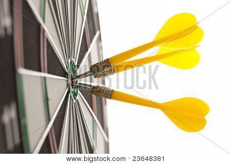 Darts hitting the bullseye