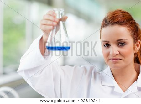 Science Student Holding An Erlenmeyr Flask