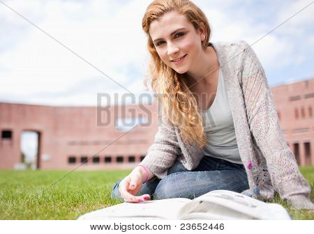 Young Woman Posing With A Book