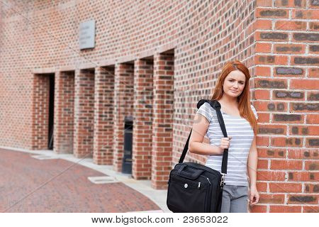Smiling Student Posing With A Bag