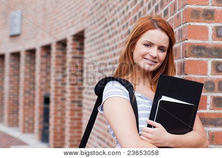 Smiling Student Holding Her Binder