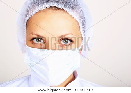 Portrait of a young female scientist wearing face mask