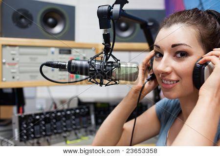 Young Radio Host Putting Her Headphones On