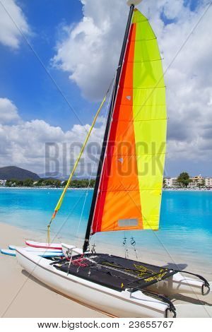 Beach of Puerto de Alcudia in Mallorca with hobie cat Balearic Islands Spain