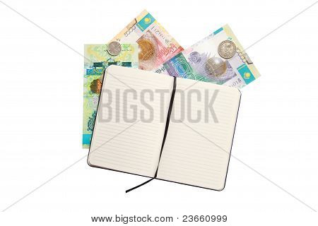 notebook and money over white