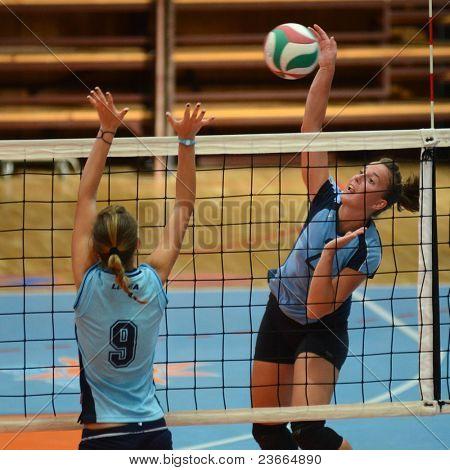 KAPOSVAR, HUNGARY - SEPTEMBER 11: Zsanett Pinter (2) in action at the Hungarian NB I. League volleyball game Kaposvar (blue) vs Budai XI. SE (light blue), September 11, 2011 in Kaposvar, Hungary.