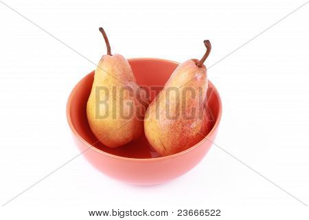 Two pears in bowl, isolated on white