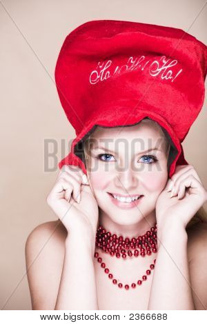 Blond Girl In Red Necklace And Hat