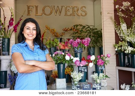 Women standing outside florists
