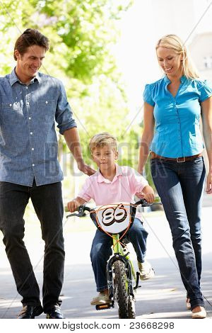 Parents with boy on bike