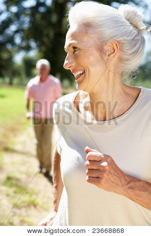 Senior couple on country run