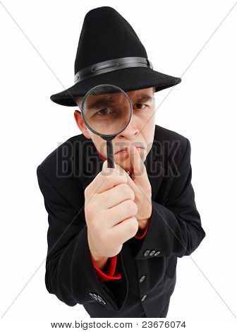 Sceptical Detective Looking Through Magnifying Glass