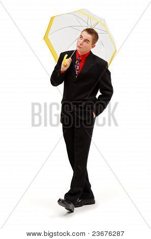 Joyful Businessman Walking With Umbrella
