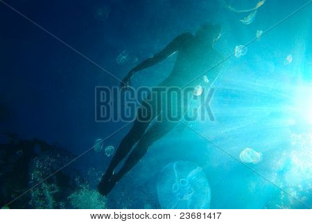 Woman floating in ocean