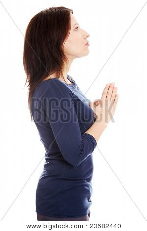 Middle aged woman praying , isolated on white