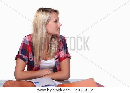 Teenage girl at desk revising