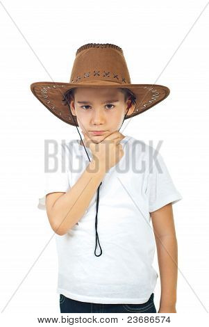 Pensive Boy In Cowboy Hat