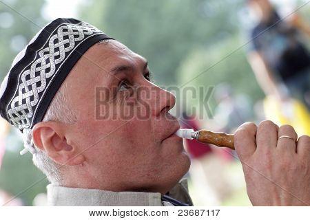 Man In Tubeteika Smoking Hookah