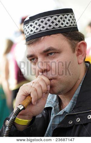 Man In Tubeteika Smoking Nargile