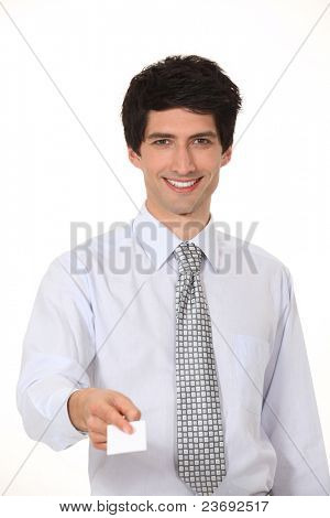 Smiling businessman offering his business card