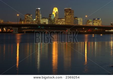 Minneapolis Skyline At Dusk Reflected In The Mississippi River