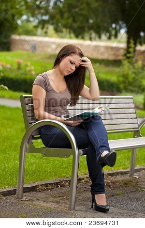 concentrated woman reading a book