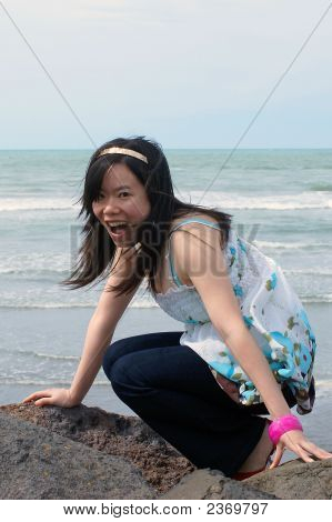 Joyful Girl On A Beach