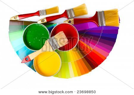open tin cans with paint, brushes and palette isolated on white