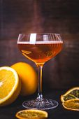 Oranges Are Reflected On The Glass Of A Glass With A Drink. Close-up Of A Glass With A Drink And Foa poster
