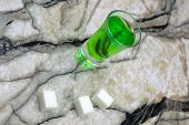Absinthe With Sugar Cubes And Spoon On Wooden Background poster