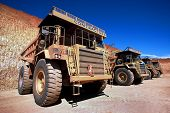 picture of dump_truck  - row of dump trucks at open cut gold mine  - JPG