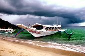 stock photo of olongapo  - A beautiful beach scene in Puerto Galera in The philippines - JPG