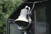 A Brass Metal Bell On A Vintage Steam Train Engine. poster