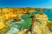 Aerial View Of High Cliff Of Praia Da Marinha In Algarve, Portugal, Europe. Scenic Landscape Of Mari poster