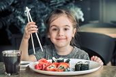 Little Girl Is Eating Sushi poster