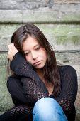 picture of teenage girl  - Outdoor portrait of a sad teenage girl looking thoughtful about troubles - JPG