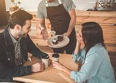 Your Order, Sir. Polite Waiter Is Serving Cakes And Coffee To Clients In Cafe. Couple Is Sitting At  poster