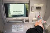 stock photo of automatic teller machine  - Person accessing Automatic Teller Machine - JPG