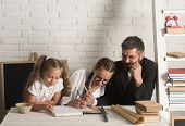 Teacher Man And Small Girls Writing At School Lesson. School Time Of Girl Sisters With Father. Back  poster