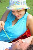 image of titillation  - a portrait of attractive couple in summer environment - JPG