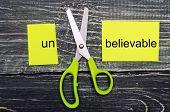 Scissors Cut The Word Unbelievable. Concept Believable. Cuts The Word un. i Can, Goal Achievement, poster