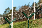 Fence With Razor Barbed Wire. Guarded Area. Military Base. Razor Wire poster
