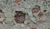 Texture Of Damaged Stone Wall. Background Of The Damaged Stone Wall poster