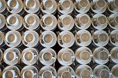 Set Of Empty White Ceramic Tea Or Coffee Cup And Saucers, Top View. Group Of Empty Cups Stacked In R poster