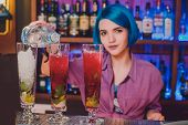 Female Bartender. Girl With Blue Hair. Cocktail Making In A Night Bar poster