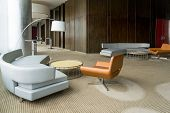 Modern Hotel Lobby With Hallway Or Office Lounge Room. Interior With Wood Paneling, Leather Sofa And poster