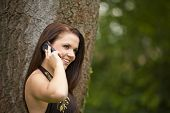 smiling brunette woman with cell phone