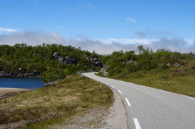 image of long winding road  - empty mountain road at the Norwegian mountains - JPG